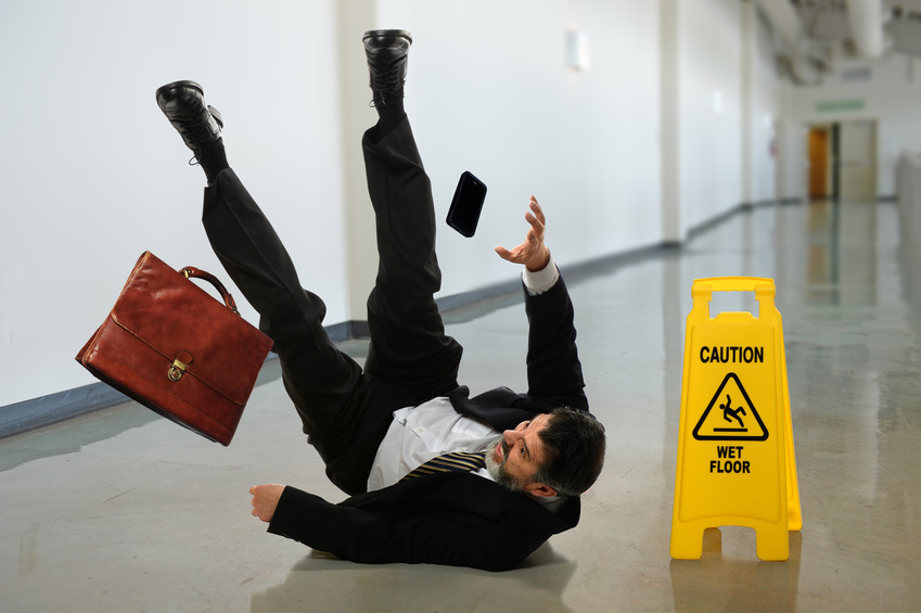 Many in a suit at work falling over.